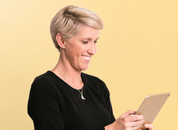 Expert partner smiling looking at an iPad