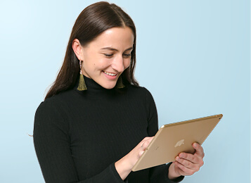 Female retailer looking at iPad